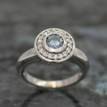 Round Cut Bezel Set with Accent Diamonds