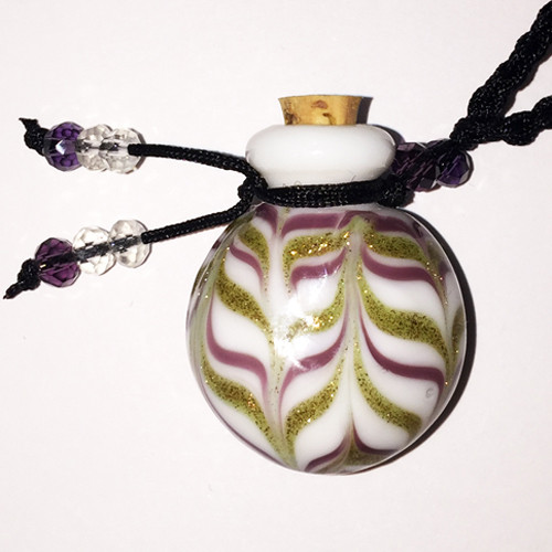 Brown Ripple Glass Bottle Cremation Pendant that holds the ashes of your loved one