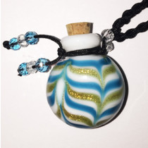 Blue Ripple Glass Bottle Cremation Pendant that holds the ashes of your loved one