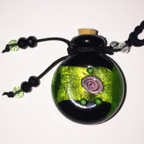 Dichroic Green Band Glass Bottle Cremation Pendant that holds the ashes of your loved one